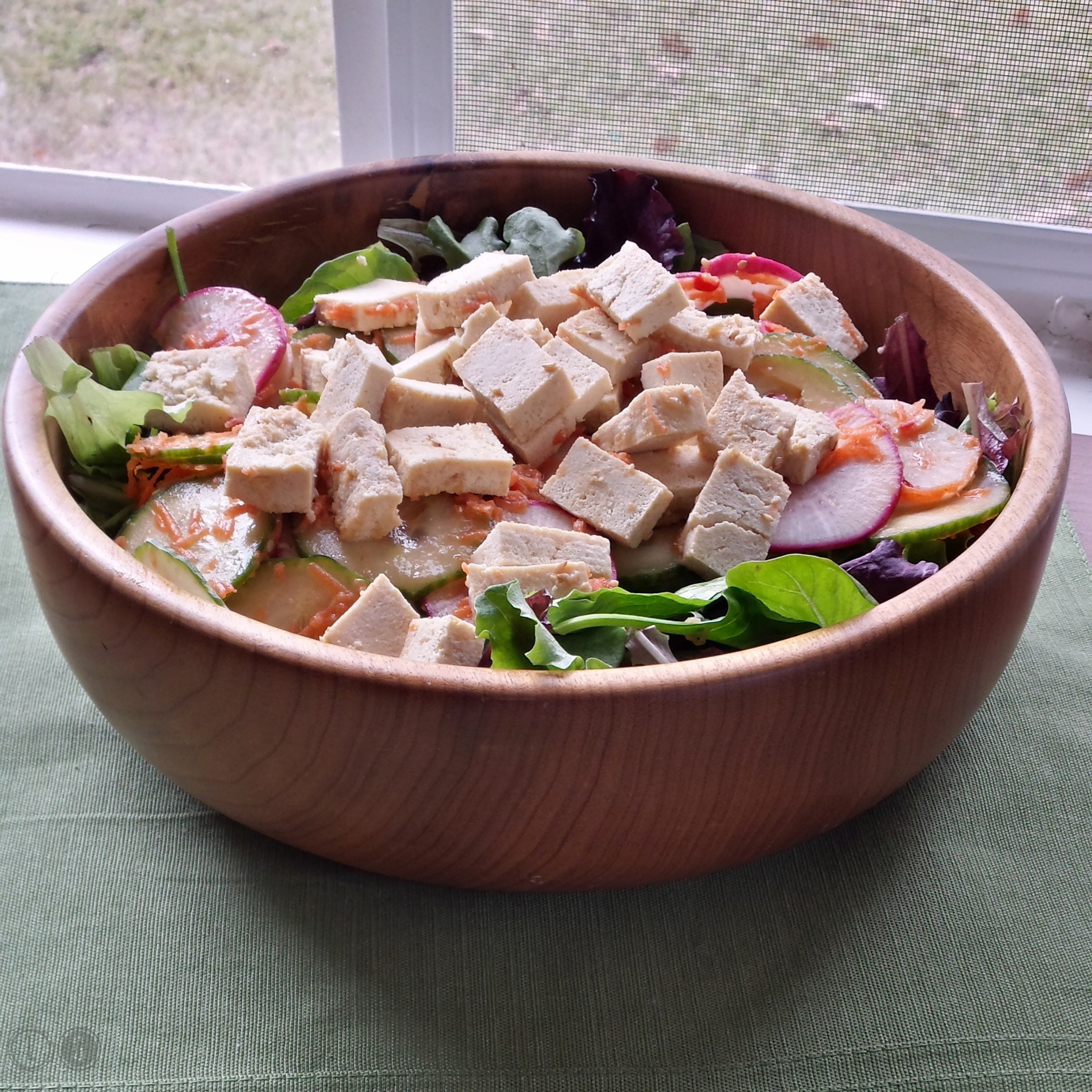 Tofu, radish, and shaved carrot salad with sesame-miso vinaigrette